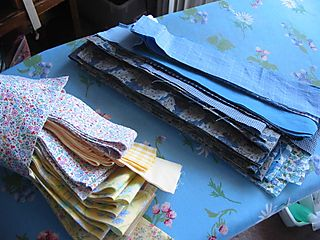 Blue log cabin quilt pieces
